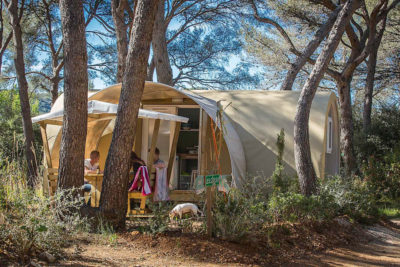 Canvas bungalows in a shaded natural and cheap campsite