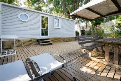 Terrace mobile home campsite in the sun